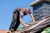 Roofer next to the chimney — Stock Photo