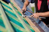 Roofer welding the gutter — Stock Photo