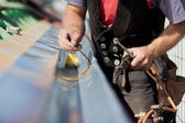 Close-up of a roofer welding the gutter — Stock Photo