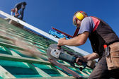 Roofer using a hand circular saw — Stock Photo