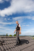 Roofer walking over an old roof — Stock Photo