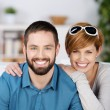 Stock Photo: Young Couple Smiling Together In House