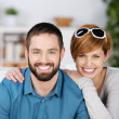 Young Couple Smiling Together In House — Stock Photo