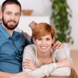 Couple Relaxing On Sofa At Home — Stock Photo