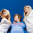 Three teenagers under a blue sunny sky — Stock Photo #28815631