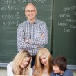 Smiling male teacher with his students — Stock Photo