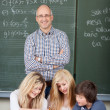 Smiling male teacher with his students — Stock Photo #28816215