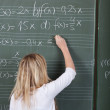 Stock Photo: Student solving maths equations