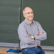Relaxed friendly male teacher — Stock Photo