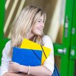 Stock Photo: Vivacious female student during break