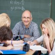 Motivated male teacher with his students — Stock Photo