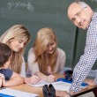 Friendly male teacher in the classroom — Stock Photo