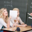 Happy student with her marked assignment — Stock Photo #28817509