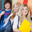 Happy Students Leaning On School Wall — Stock Photo #28817873