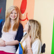 Students Looking At Each Other While Leaning On School Wall — Stock Photo