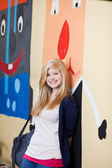 Pretty young blond girl at school — Stock Photo