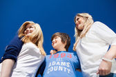 Three teenagers under a blue sunny sky — Stock Photo