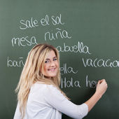 Happy young girl in Spanish class — Stock Photo
