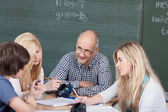 Teacher and his students in a group discussion — Stock Photo