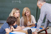 Teacher giving a lesson — Stock Photo