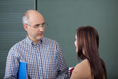 Lecturer and student in a discussion — Stock Photo