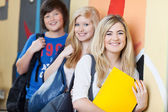 Happy Students Leaning On School Wall — Stock Photo