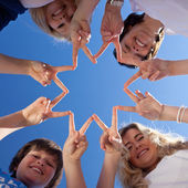 Children And Teacher Forming Star With Fingers Against Blue Sky — Stock Photo