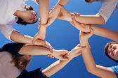 Children And Teacher Forming Frame While Holding Hands Against B — Stock Photo