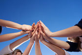 Hands Together Against Clear Blue Sky — Stock Photo