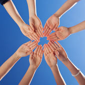 Students And Teacher's Hands Together Against Blue Sky — Stock Photo