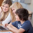 Students Using Laptop Together At Desk — Stock Photo #28820145