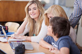 Female Students With Friends At Desk — Stock Photo