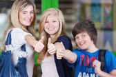 Happy Students Showing Thumbs Up Sign Together In School — Stock Photo