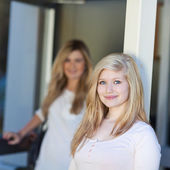Teenage Girl Smiling While Friend Standing In Background — Stock Photo