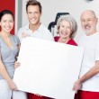 Group of fitness enthusiasts with a blank sign — Stock Photo #29507001