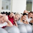 Smiling elderly woman training in a group — Stock Photo