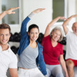 Enthusiastic group doing aerobics at a gym — Stock Photo