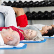 Elderly woman working out in a gym — Stock Photo #29507649