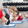Young man doing a fitness course — Stock Photo