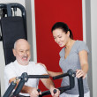 Personal fitness trainer with a senior man — Stock Photo