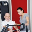 Stock Photo: Personal fitness trainer with a senior man