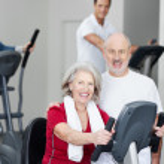 Senior couple training in a gym — Stock Photo