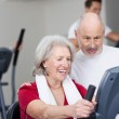 Senior woman working out at the gym — Stock Photo