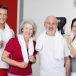Stock Photo: Happy Family Standing Together In Gym