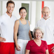 Family Smiling Together In Gym — Stock Photo #29508815
