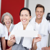 Friendly young woman with a sign at a spa — Stock Photo