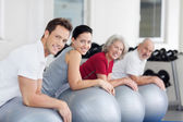 Group exercising in a gym — Stock Photo