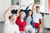 Group of people doing aerobics at the gym — Stock Photo