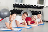 Group of people relaxing while training at the gym — Stock Photo