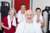 Senior Man Smiling With Family In Gym — Stock Photo